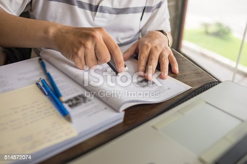 470761441 istock photo Man use eraser to delete the wrong word on book 514572074