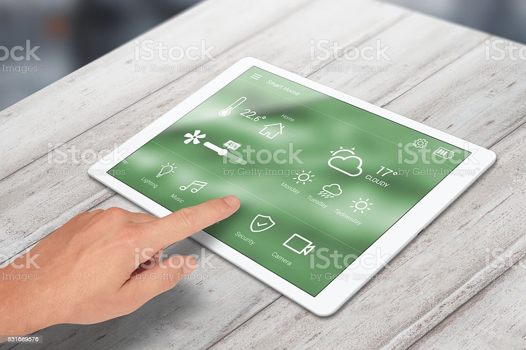 Man use smart home control on tablet. stock photo