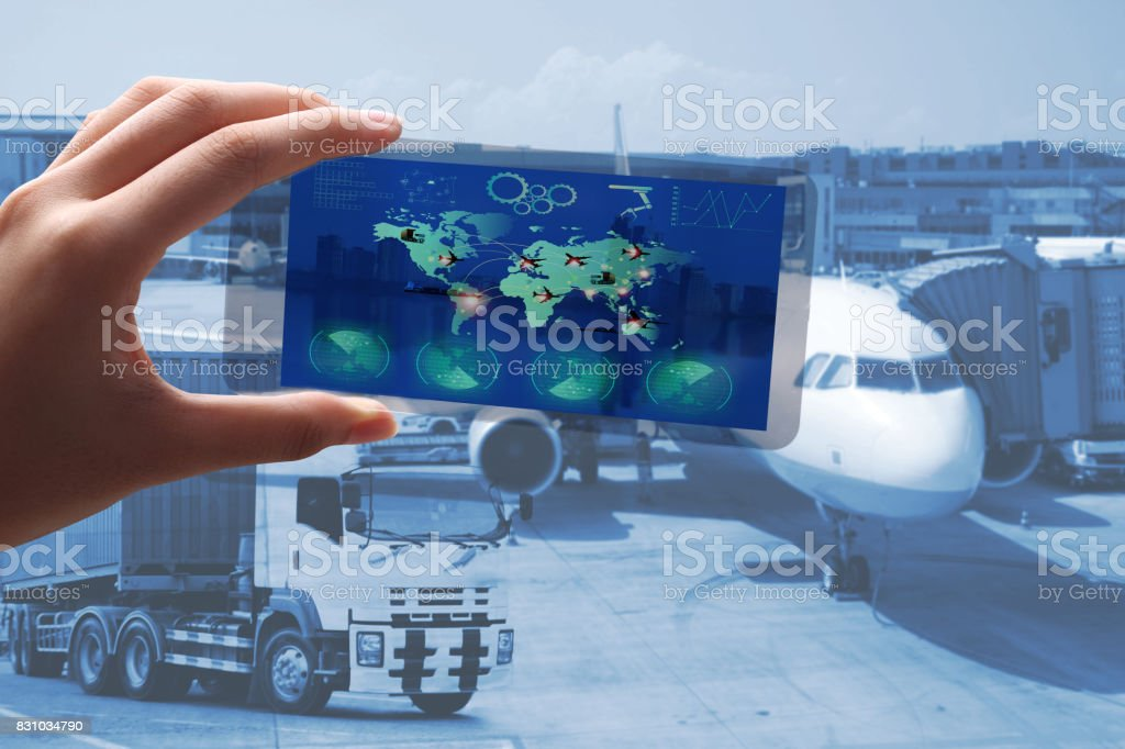 A man  use the transparent phone  watch the transportation or import export business. Logistics and transportation of Container Cargo ship and Cargo plane , logistic import export and transport industry background stock photo