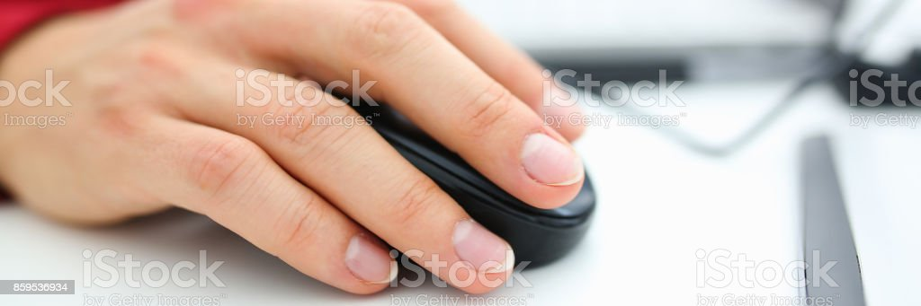 Man used computer mose holding in hand search for information stock photo