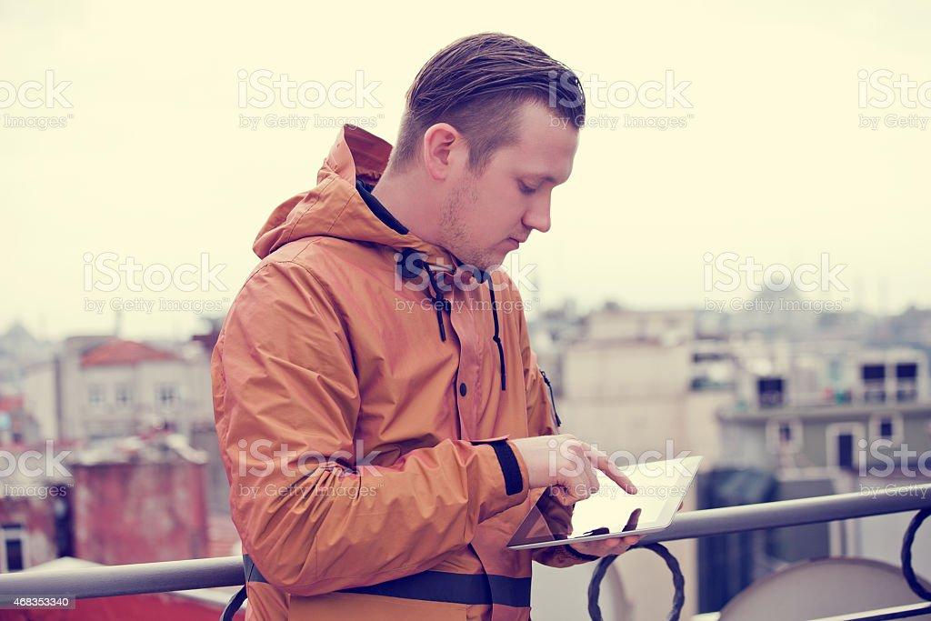 Man uses digital tablet royalty-free stock photo