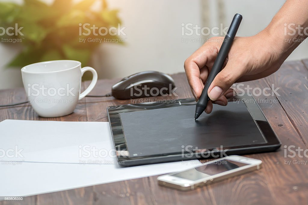 Man uses graphics tablet. stock photo