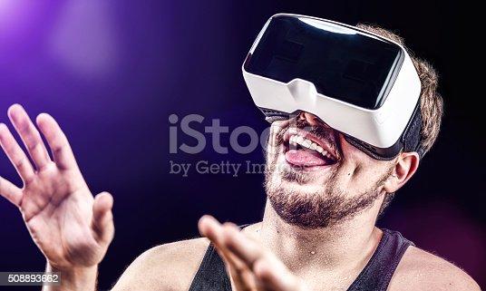 istock Man uses Virtual Reality VR head-mounted display 508893662