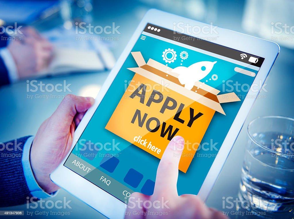Man Using a Digital Tablet Online Application stock photo
