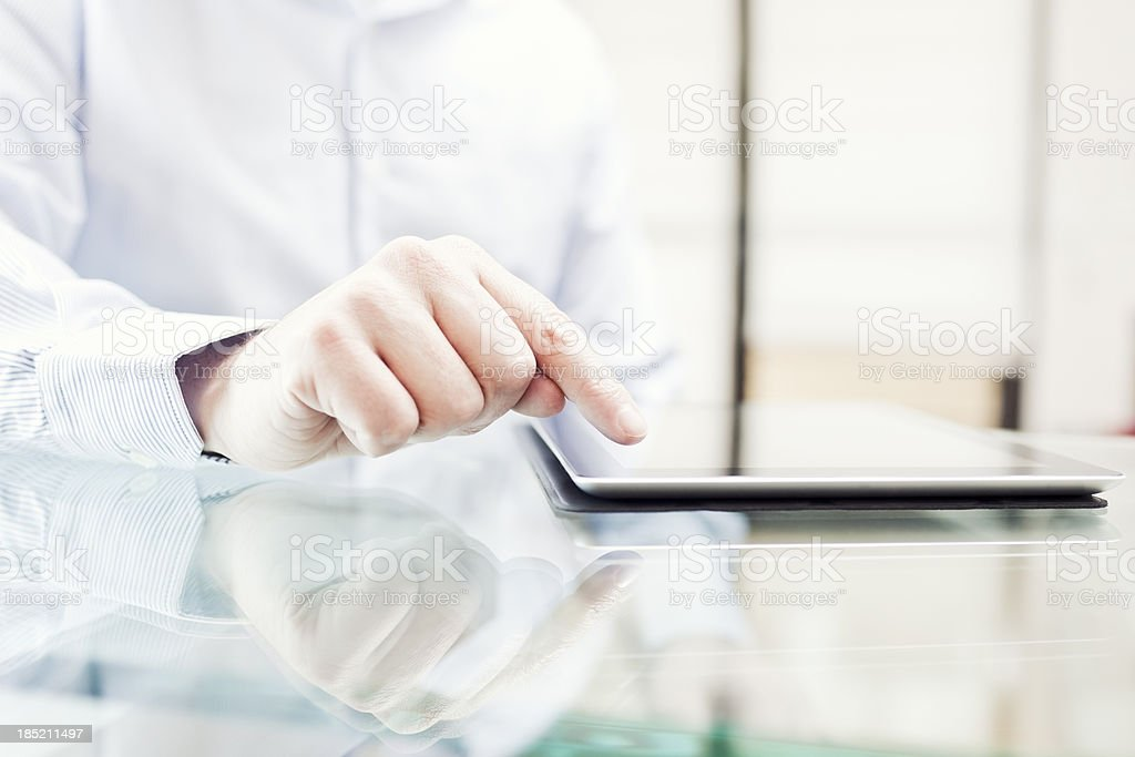 Man using a digital tablet royalty-free stock photo