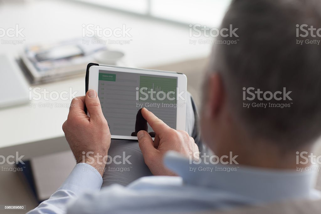 Man using a digital tablet royalty-free stock photo
