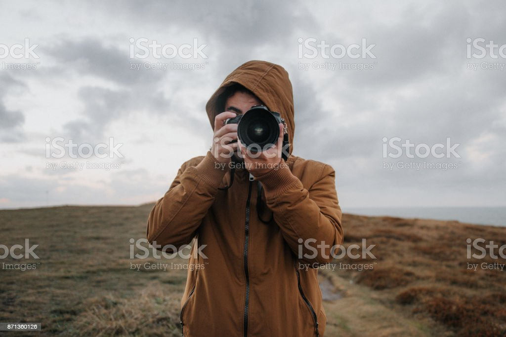 Man using a DSLR camera stock photo