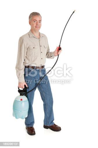 927641110 istock photo Man Using a Garden Sprayer 185095131
