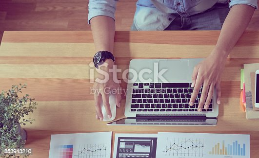 istock Man using a laptop in the display and technology advances in stores. Take your screen to put on advertising. 853943210