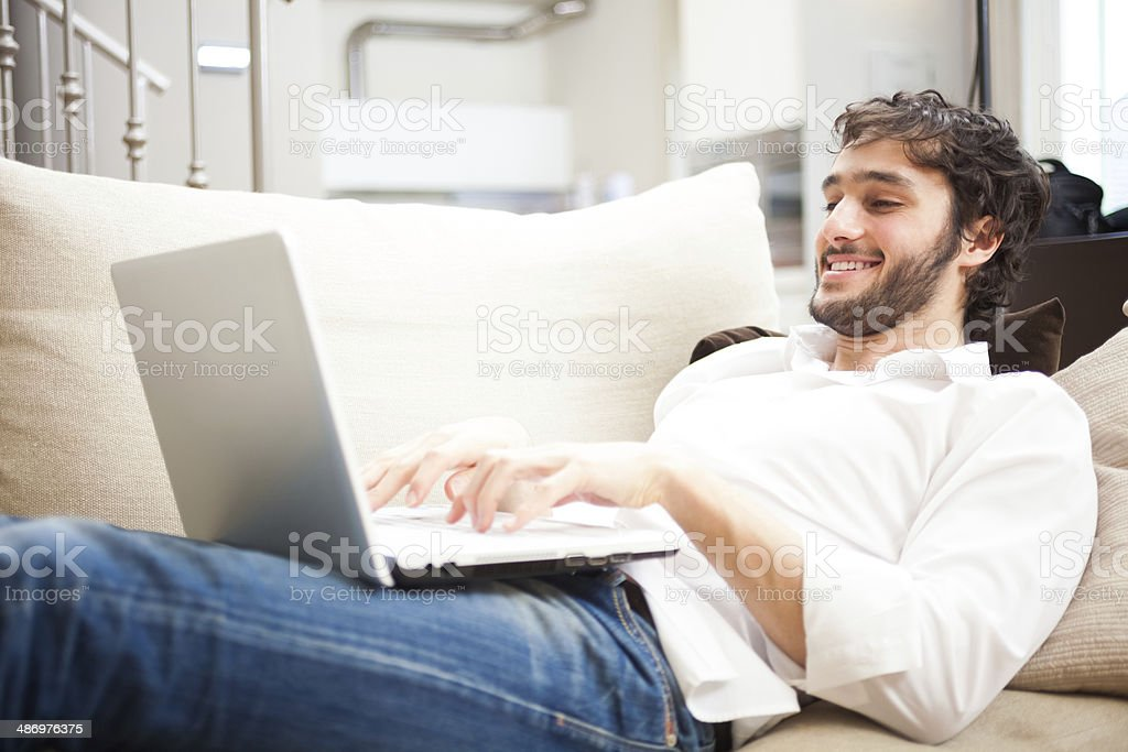 Man using a laptop stock photo