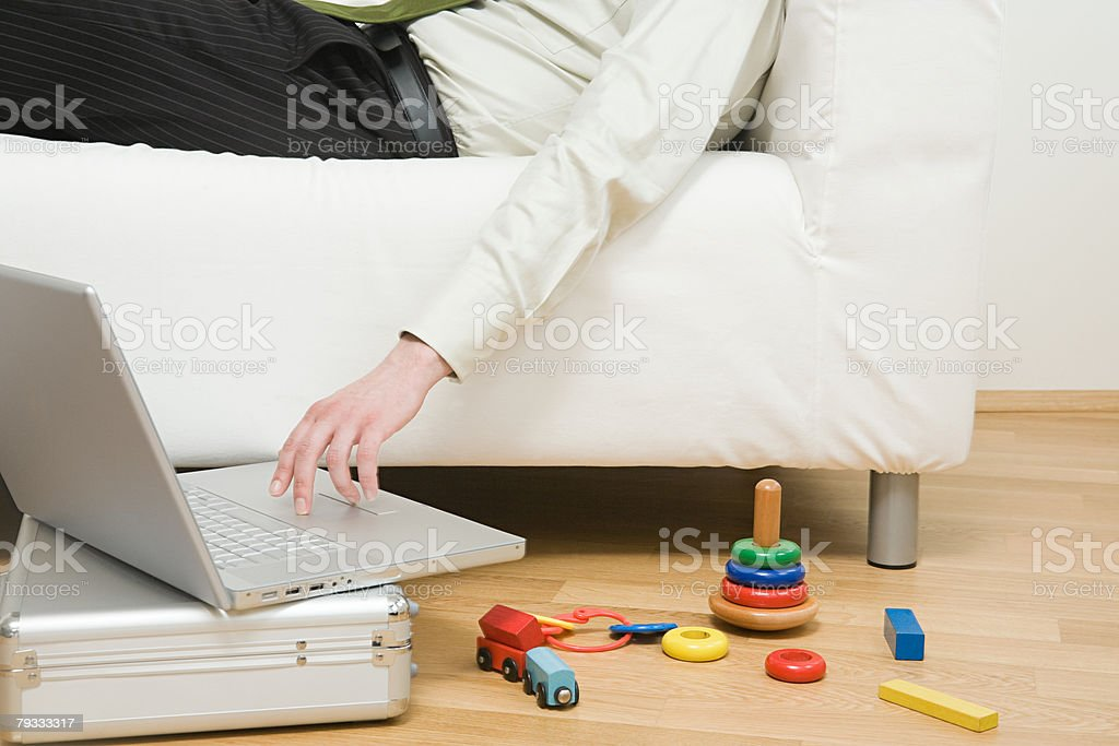 A man using a laptop royalty-free stock photo