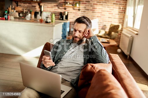 istock Man using a Phone 1125254563