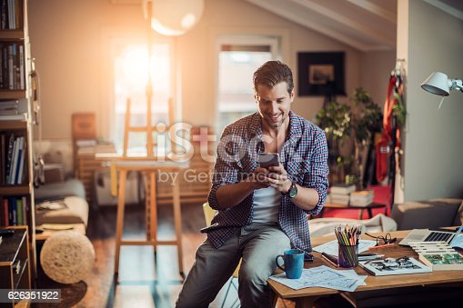istock Man using a phone 626351922