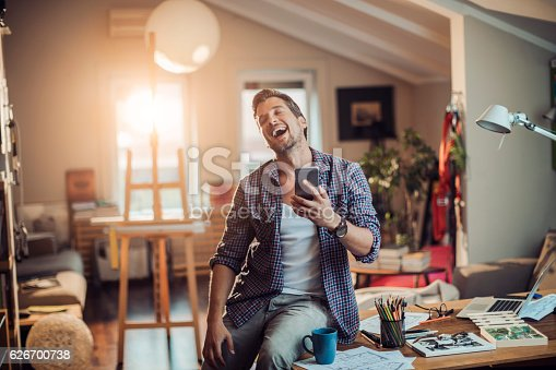 istock Man using a phone 626700738
