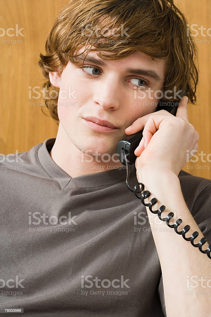 A man using a phone royalty-free stock photo