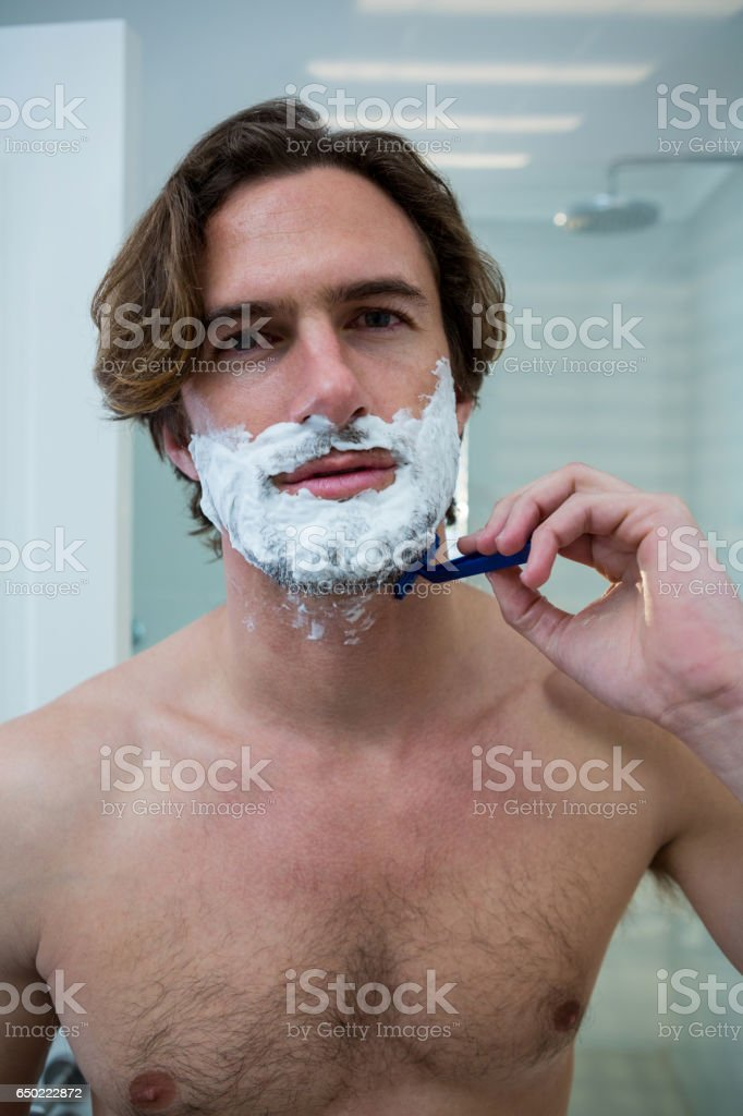 Man Using A Razor To Shave His Beard Off Stock Photo Download Image Now Istock