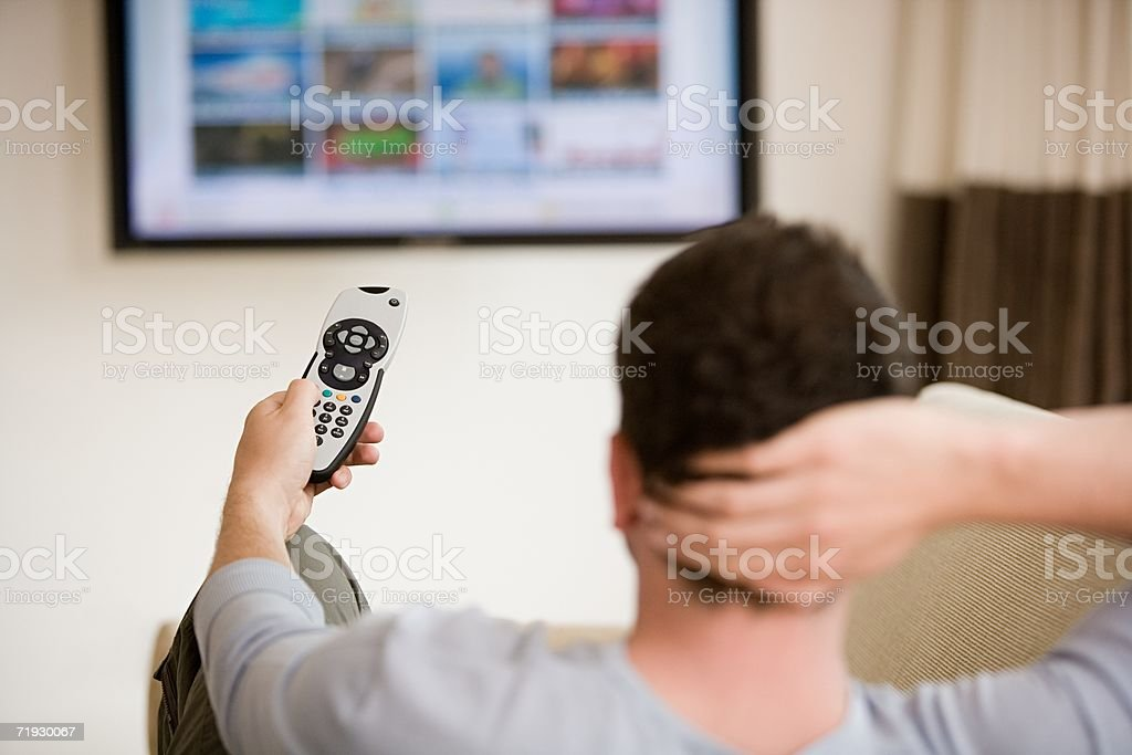 Man using a remote control royalty-free stock photo