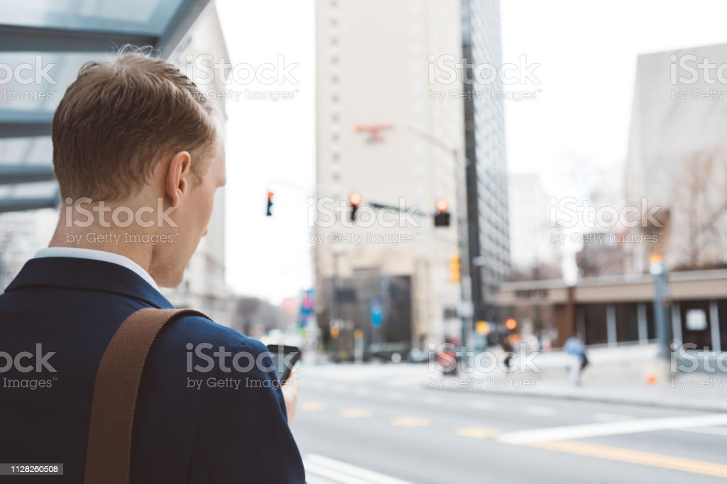 man using a smart phone out in the city stock photo
