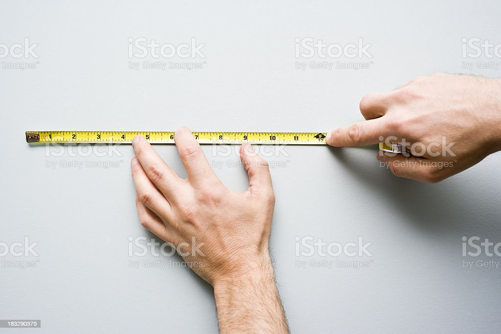 Man using a tape measure for Home Renovations stock photo
