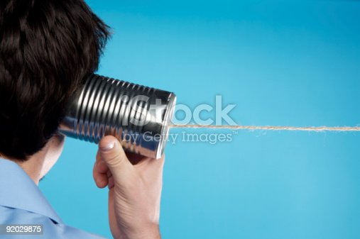 Man using a tin can telephone.