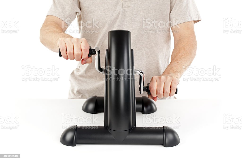 Man Using an Arm Exercise Machine stock photo