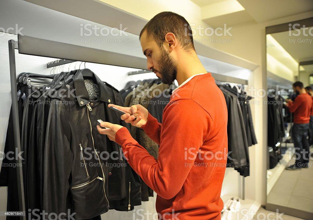 Man Using Barcode Reader Through Smart Phone royalty-free stock photo