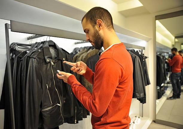 Man Using Barcode Reader Through Smart Phone stock photo