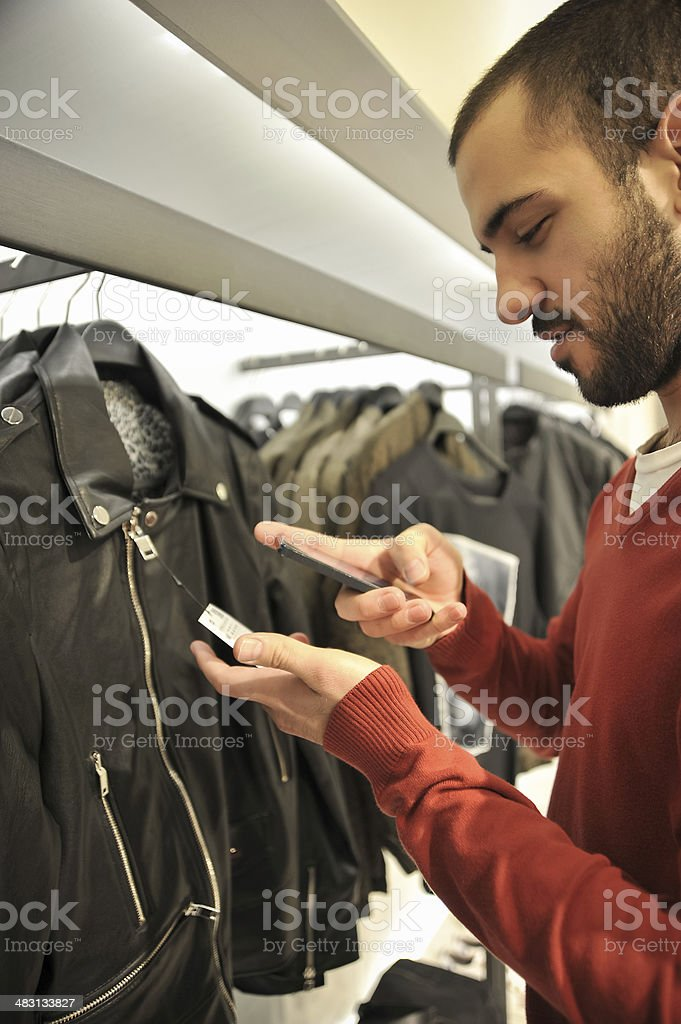 Man Using Barcode Reader Through Smart Phone stock photo
