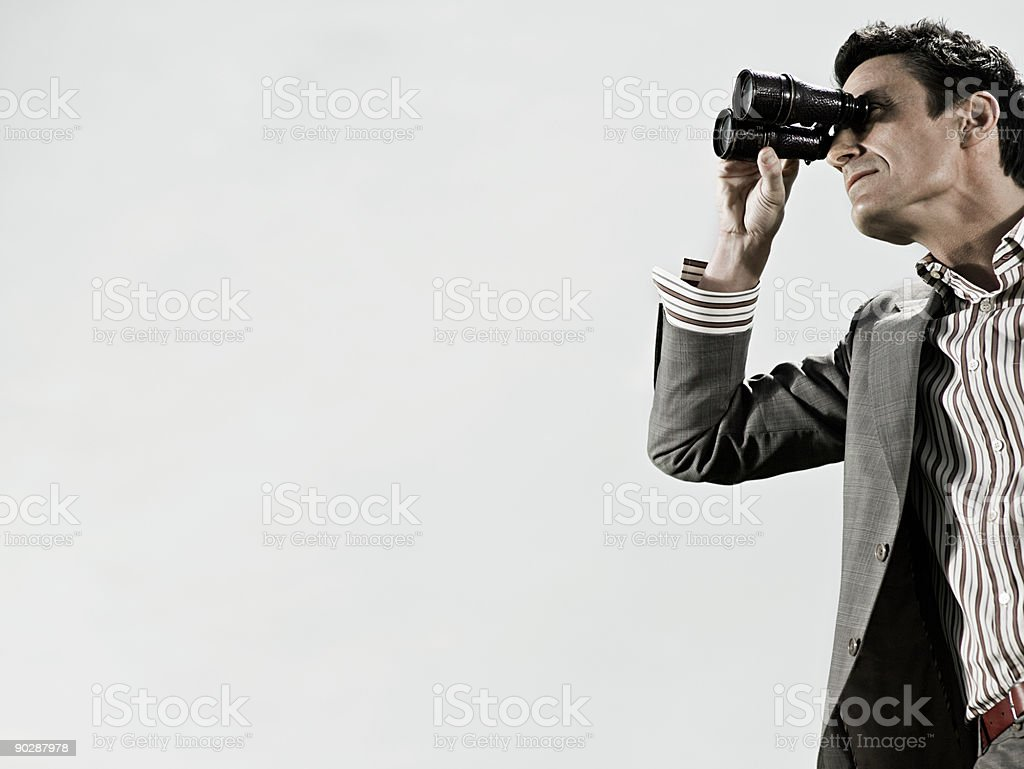 Man using binoculars stock photo