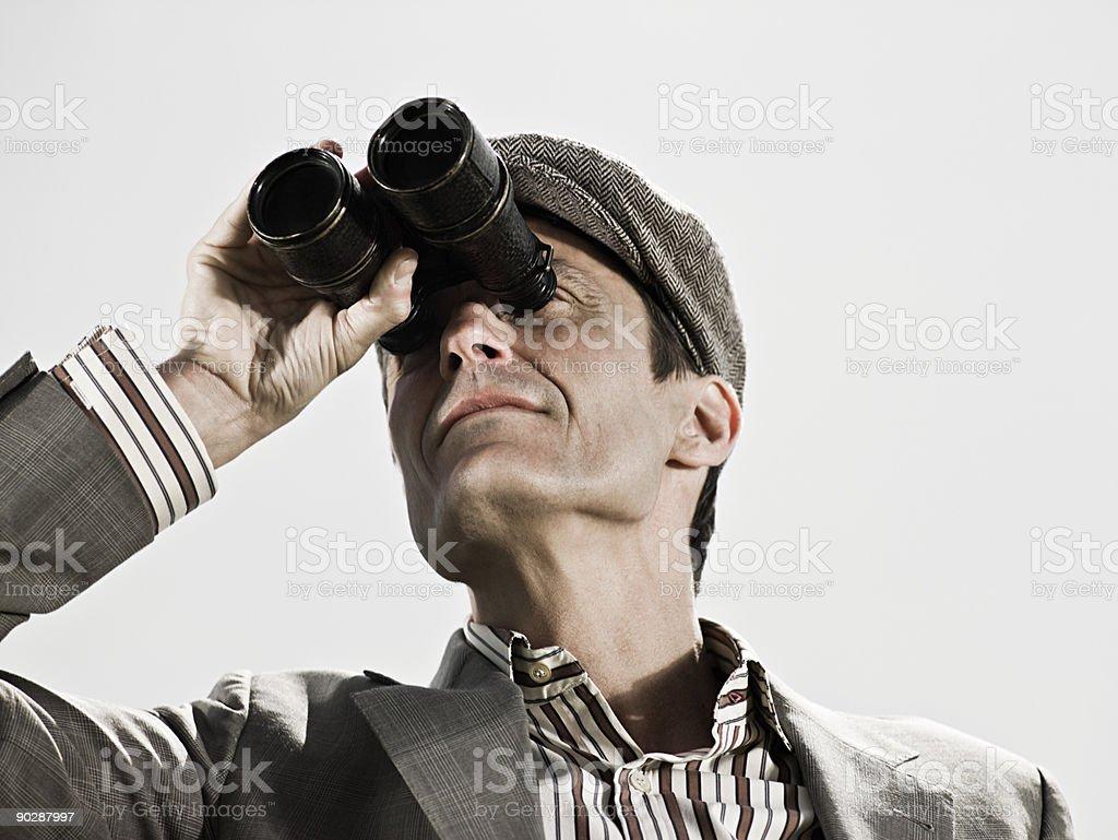 Man using binoculars stock photo