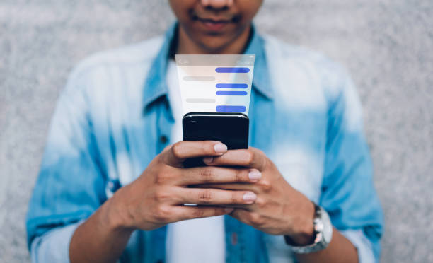 Man using chat message app on smartphone, in response to communication stock photo