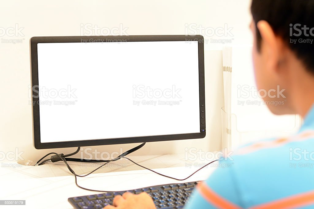 Man using computer with blank screen stock photo