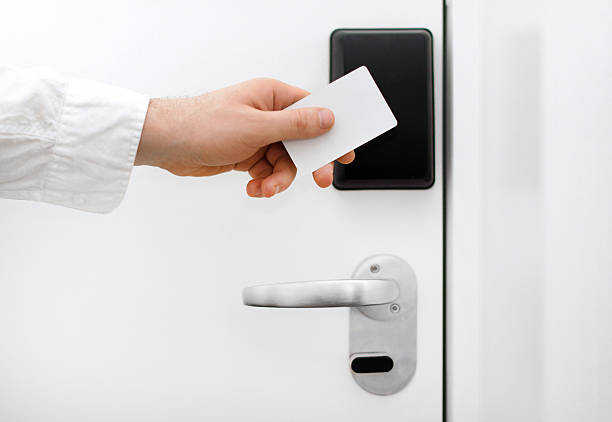 Man using contactless key in the hotel. Man using contactless key in the hotel. cardkey stock pictures, royalty-free photos & images