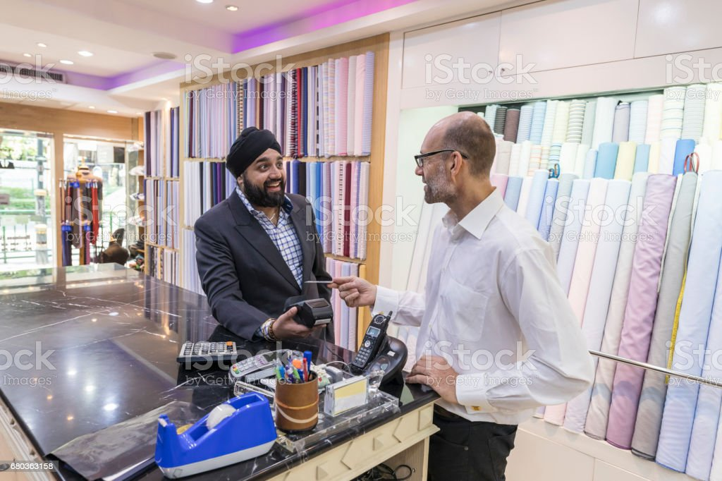 Man Using Contactless Payment to Pay in a Shop royalty-free stock photo