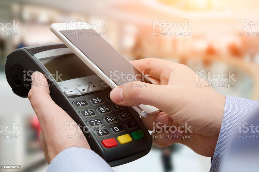 Man using credit card payment machine stock photo