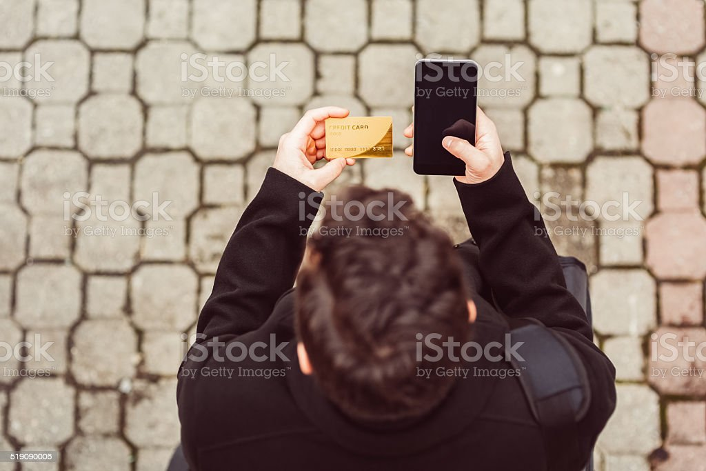 Man using credit card stock photo