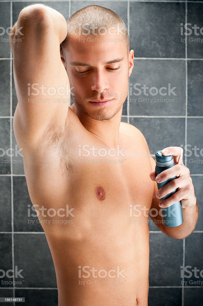 Man using deodorant stock photo