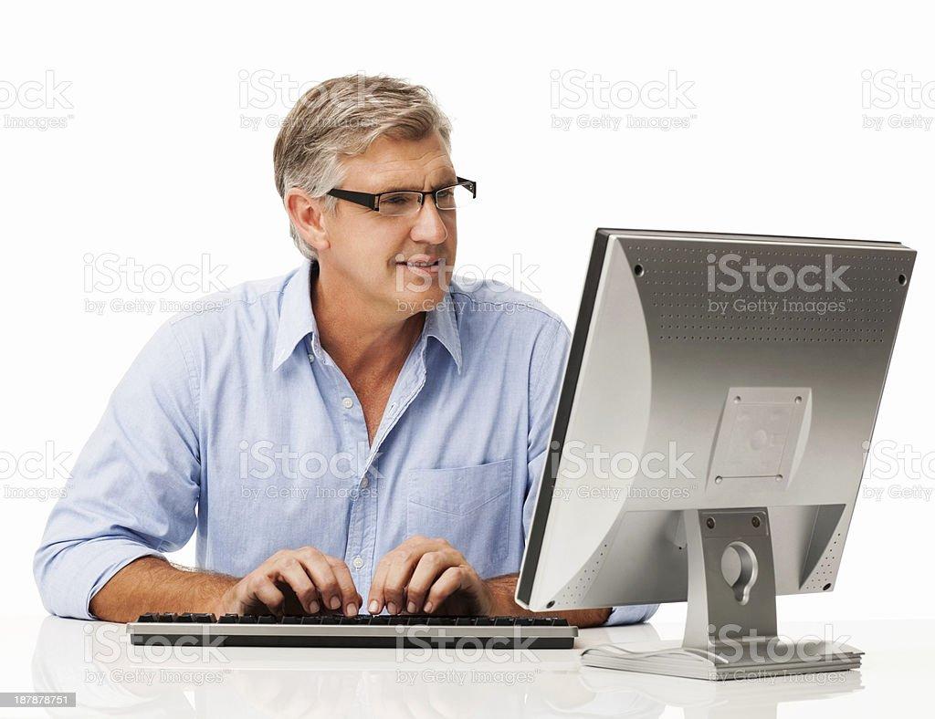 Man Using Desktop PC At Desk stock photo