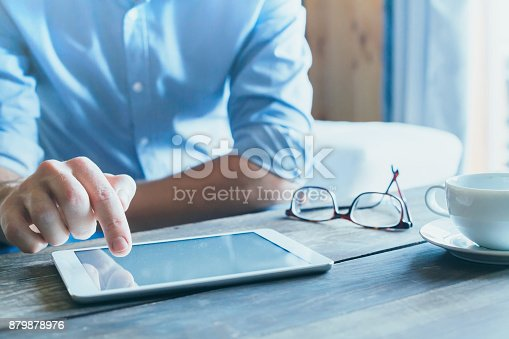 istock man using digital tablet computer, close up 879878976
