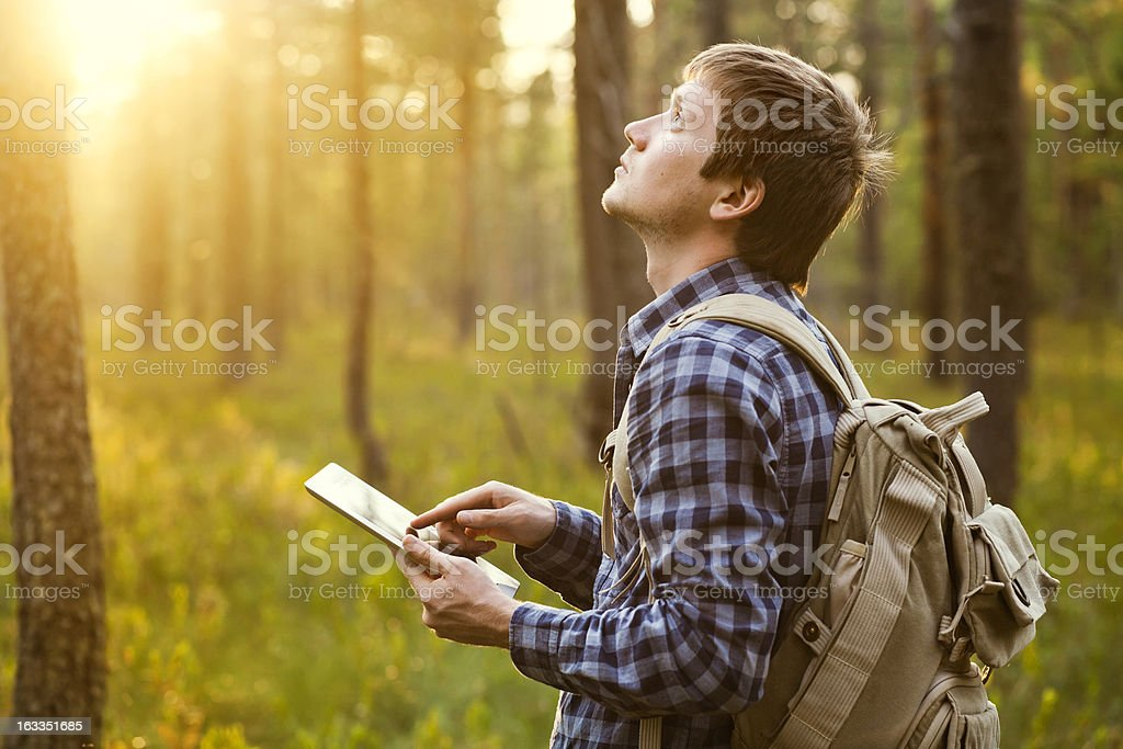 Man using digital tablet in the nature in a sunny day royalty-free stock photo