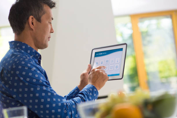 Man using digital tablet stock photo