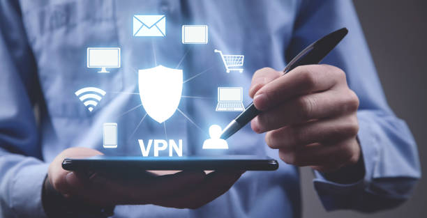 Man using digital tablet. VPN concept Man using digital tablet. VPN concept vpn stock pictures, royalty-free photos & images