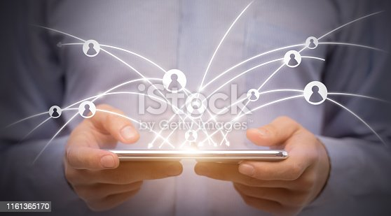 497982910 istock photo Man using digital tablet with social icons, worldwide networking 1161365170