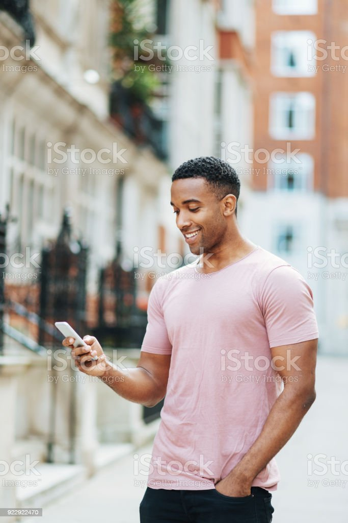 Man using electronic banking on his smart phone stock photo