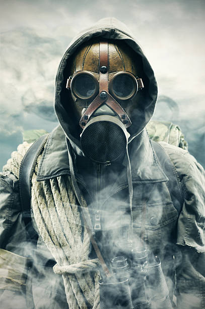 Royalty free gas mask pictures images and stock photos istock man using gas mask to protect himself from pollution stock photo voltagebd Images