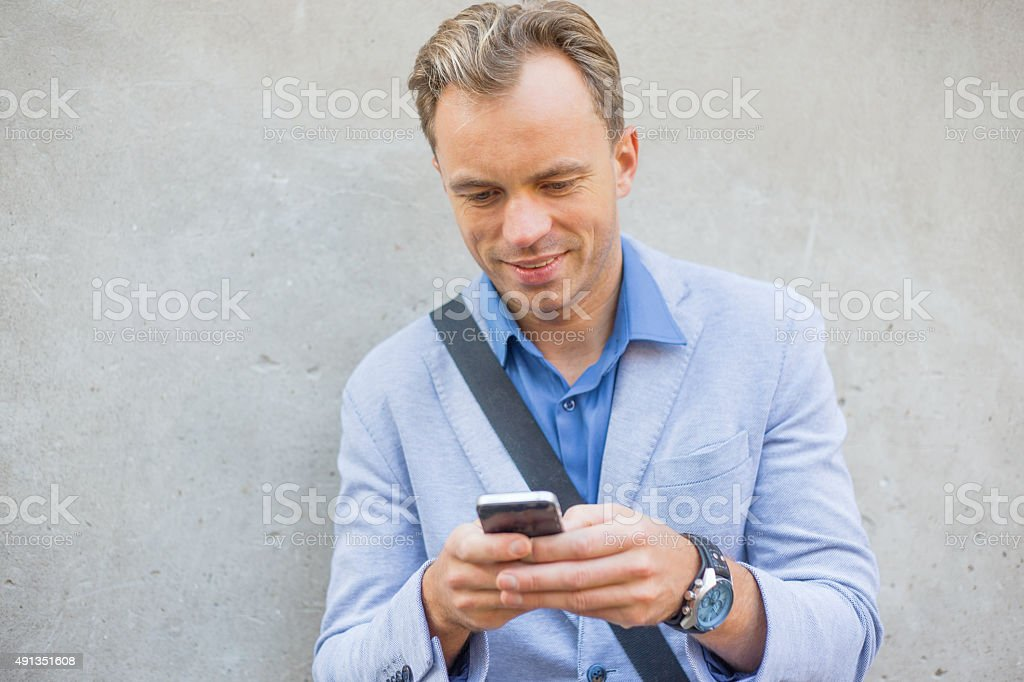 Man using his cellphone stock photo