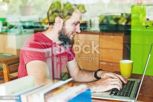 istock man using his laptop 492672886