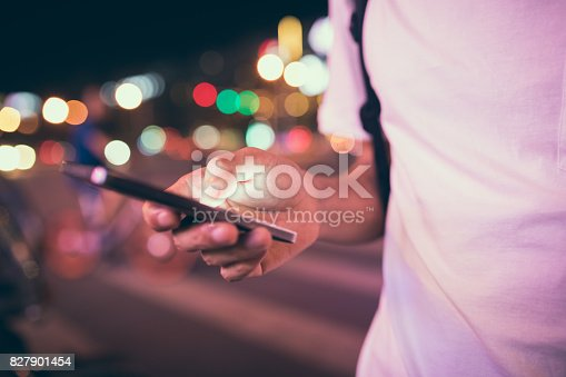 istock Man using his mobile phone in the street 827901454