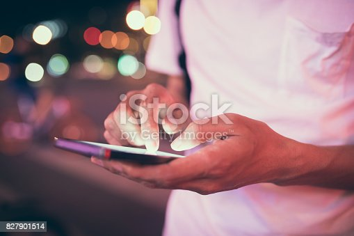 istock Man using his mobile phone in the street 827901514