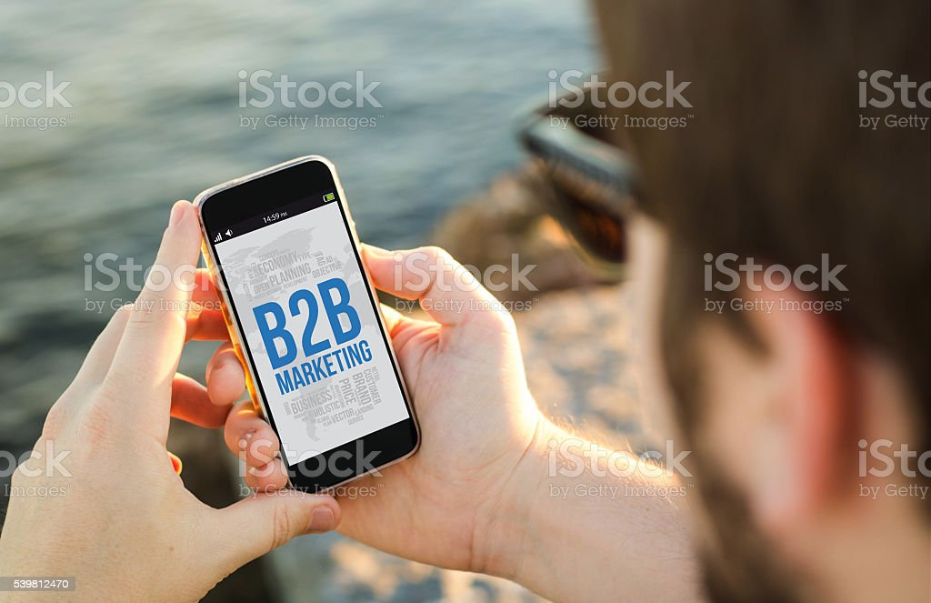 Man using his mobile phone  with b2b marketing on sc stock photo
